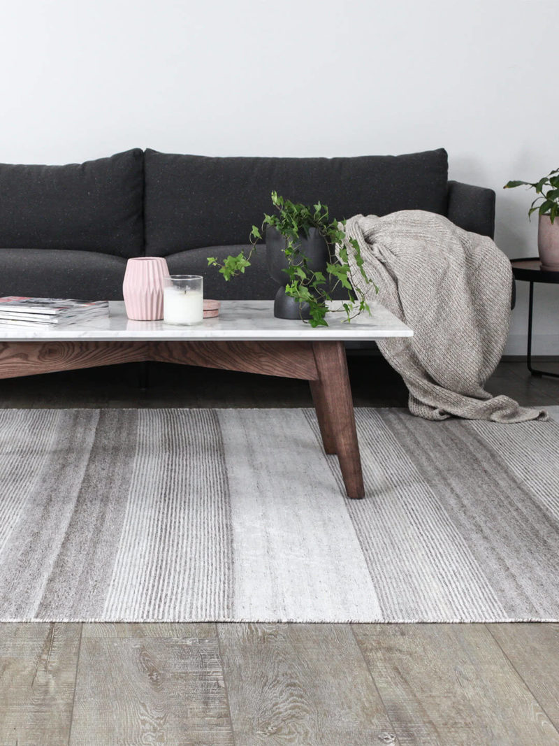 Vetro taupe reversible rug handmade in taupe lifestyle shot stripe side