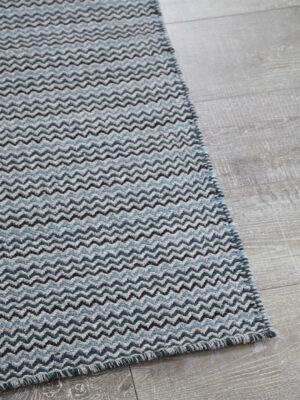 braid ripple handmade flatweave rug corner close up