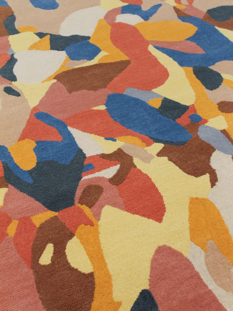 An abstract multi colour rug, handtufted from 100% wool New Zealand blend.
