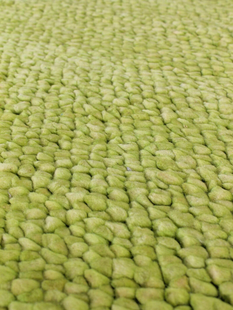 Sprightly in Green is a Handwoven textured rug made from NZ felted Wool.