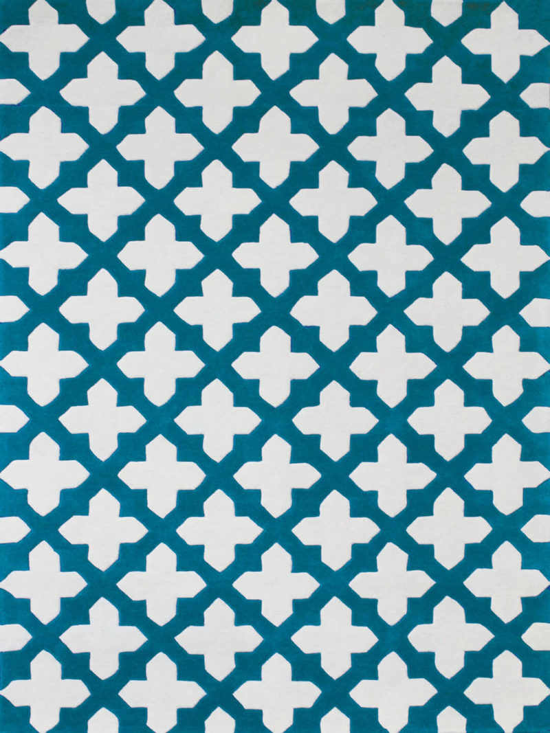 The Empire Rug in Aqua Blue is a handtufted rug made from New Zealand wool, with a two-tone cross design.