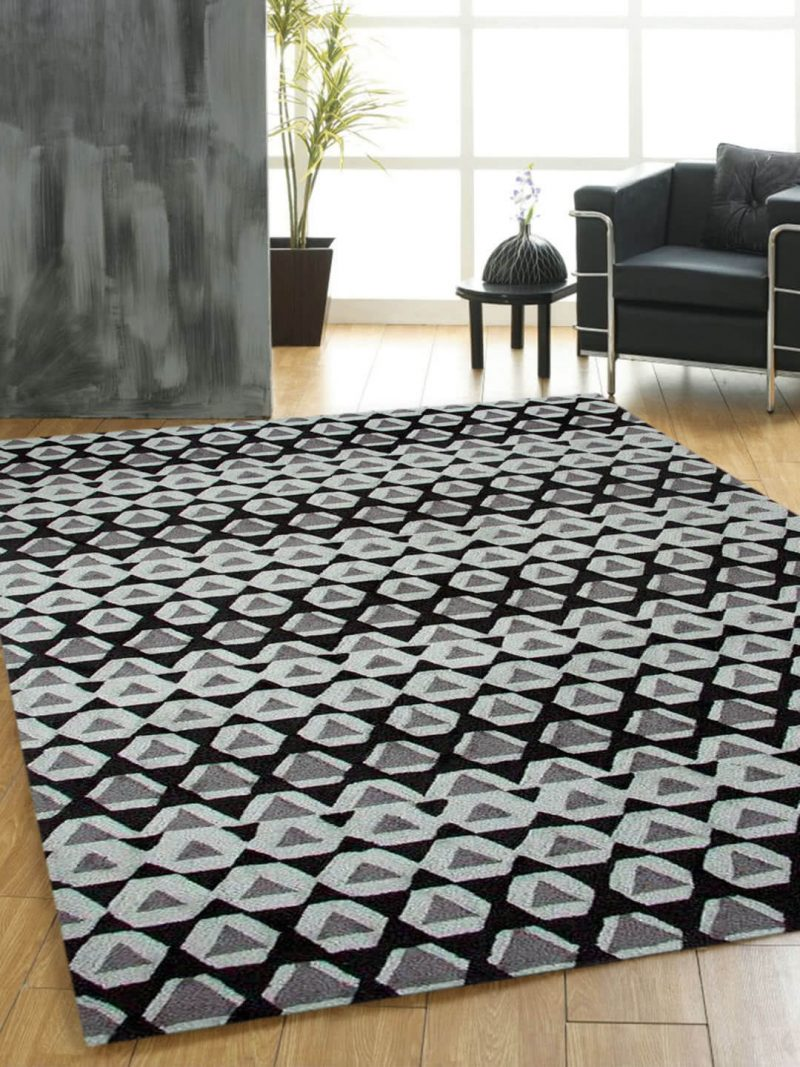The Gypsy rug in Charcoal is a bold graphic design, handtufted in New Zealand wool blend