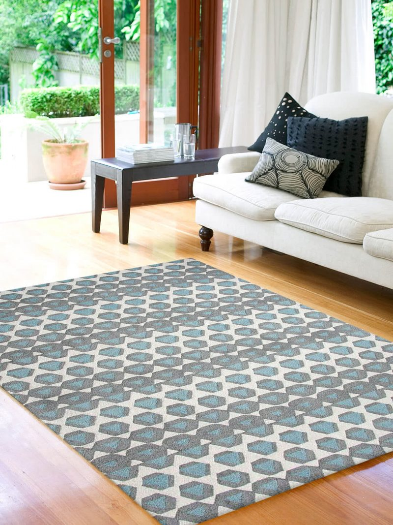 The Gypsy rug in Sea Breeze is a bold graphic design, handtufted in New Zealand wool blend with tones of Blue, Cream and Grey