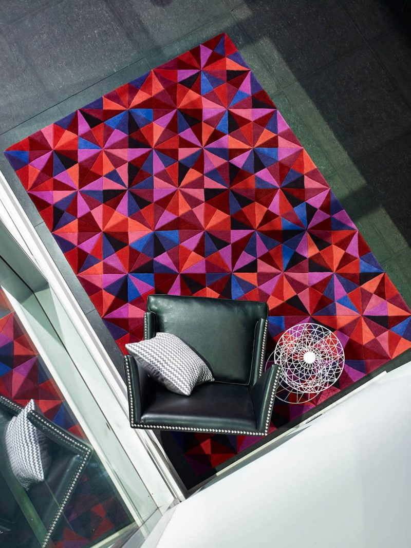 Jewel Citrus Berry is A bold geometric rug with intricate carving detail. Hand-tufted as a 100% wool New Zealand blend.