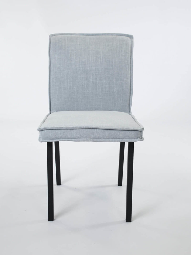 Bella Dining chair Cloud. Fully upholstered dining chair with flange edge and black metal legs.