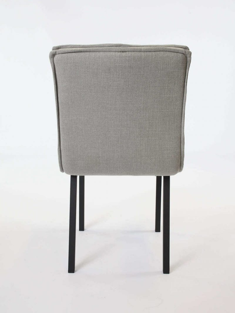 Bella Dining chair in Dove. Fully upholstered dining chair with flange edge and black metal legs.