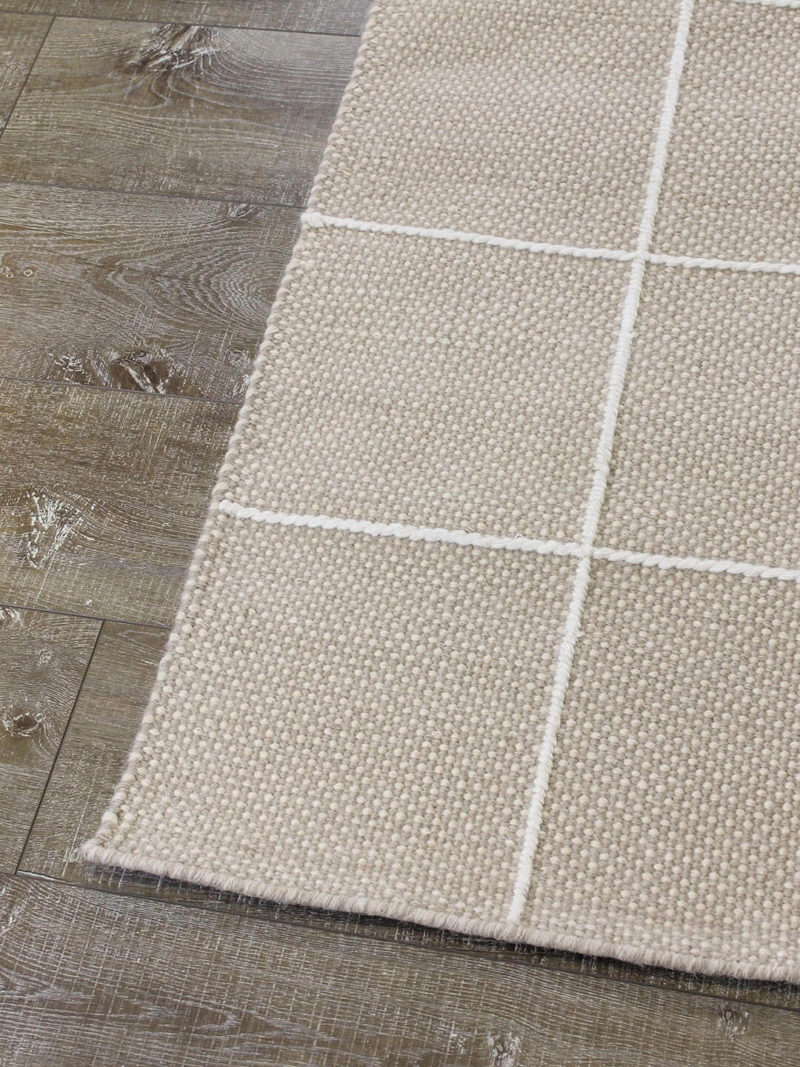 Resolve cashmere rug by Shaynna Blaze handmade form pure wool in cream and white corner