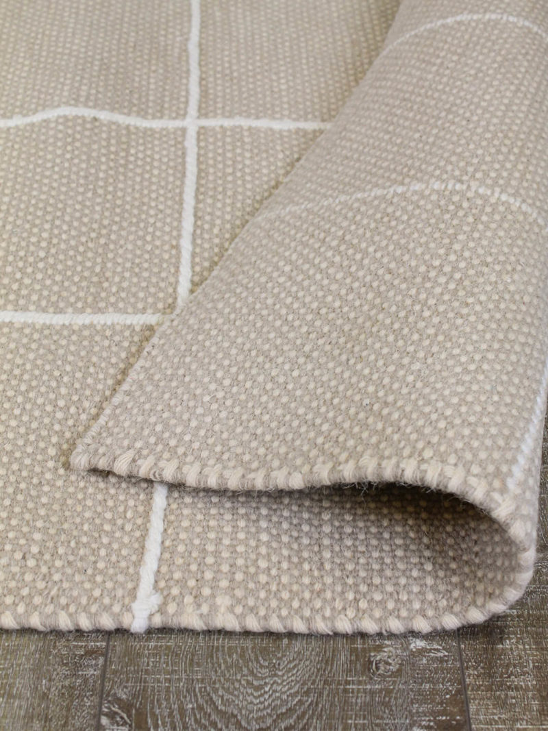 Resolve cashmere rug by Shaynna Blaze handmade form pure wool in cream and white back
