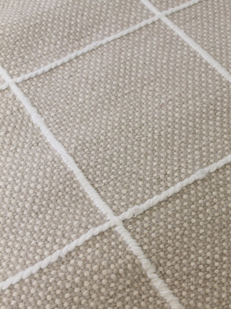 Resolve cashmere rug by Shaynna Blaze handmade form pure wool in cream and white close up