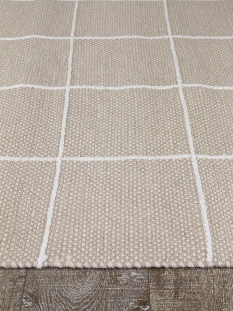 Resolve cashmere rug by Shaynna Blaze handmade form pure wool in cream and white thickness of rug