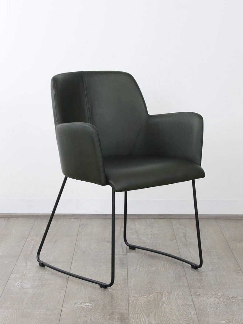 Franklin Dining Chair in Dark Green. Semi-aniline Brazilian Leather upholstered dining chair with black powdercoated metal base.