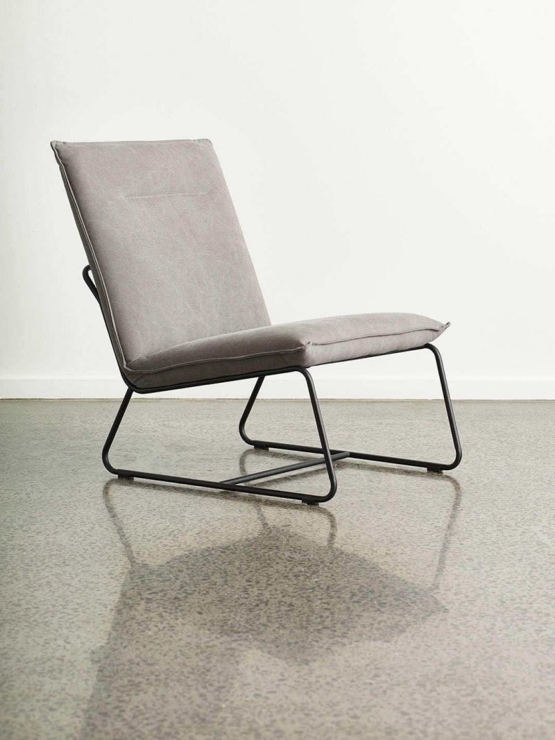 Tyler Occasional Chair in Espresso. Fully upholstered armless occasional chair with powdercoated black metal base. Upholstered seat in stonewashed fabric.