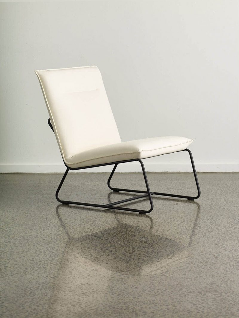 Tyler Occasional Chair in Shell White. Fully upholstered armless occasional chair with powdercoated black metal base. Upholstered seat in stonewashed fabric.