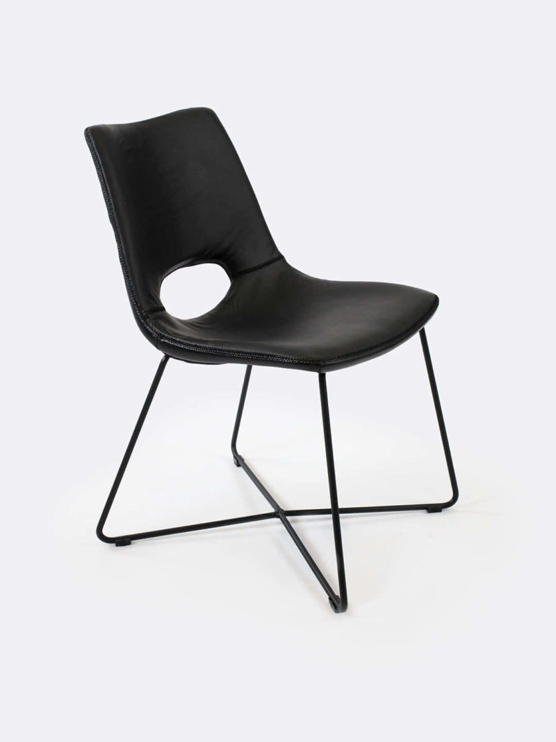 Ezra Gunmetal dining Chair. Semi-aniline Brazilian Leather upholstered dining chair with black powdercoated metal base.