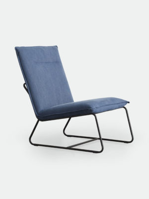 Ryder Occasional Chair in Indigo blue. Fully upholstered armless occasional chair with powdercoated black metal base. Upholstered seat in stonewashed fabric.
