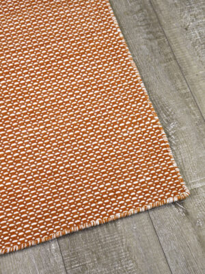 Aura flatweave rug in brick terracotta orange