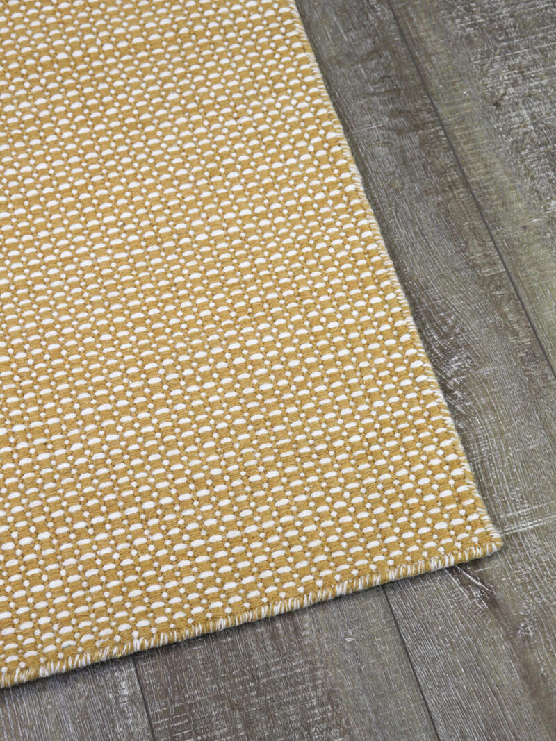 Aura flatweave rug in spice gold yellow