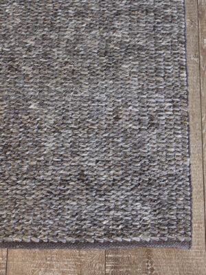 Madison Carbon handmade textured grey rug - corner image