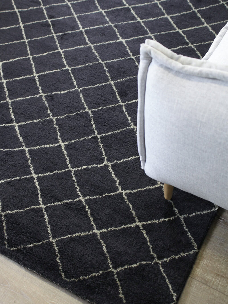 Nordic Diamond handknotted wool rug in Charcoal - lifestyle image