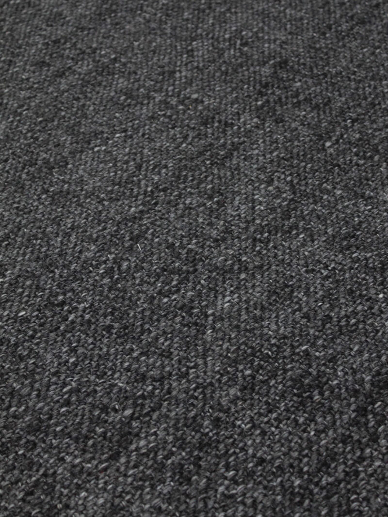 Positano handwoven wool rug with fringe in Dark Grey - detail image