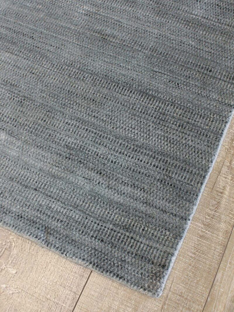 Windsor Black/Silver handknotted New Zealand wool and luxurious artsilk rug, with a delicate linear pattern