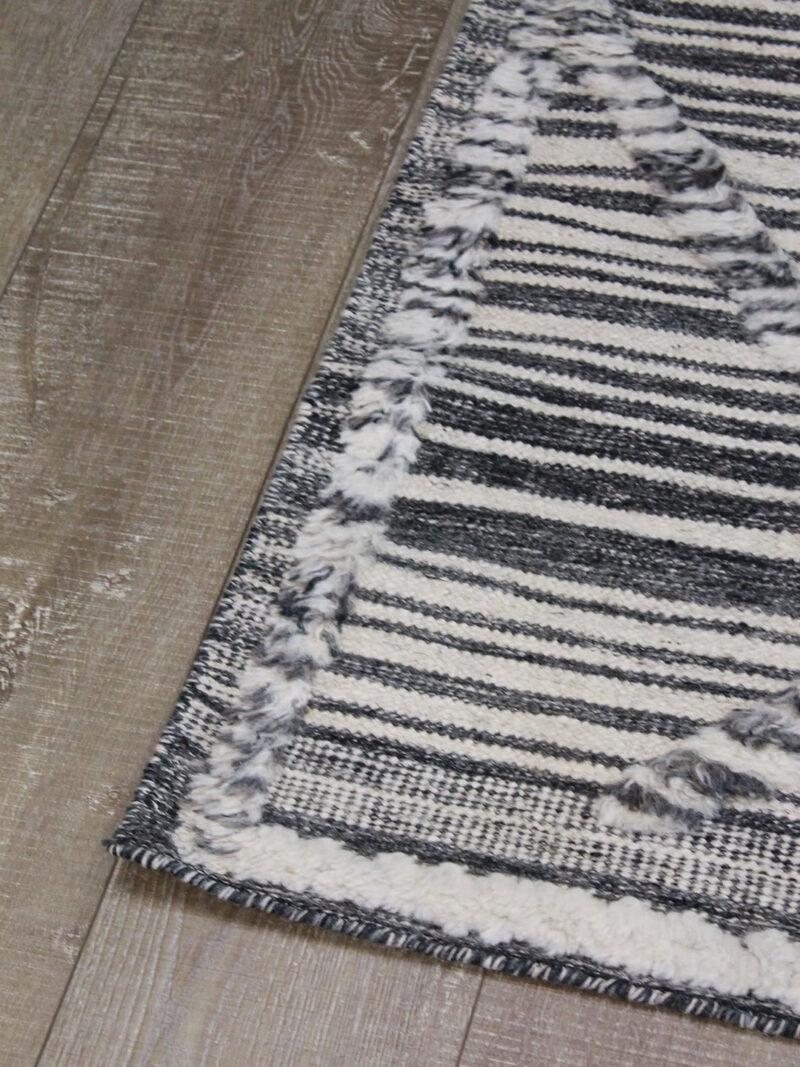 Salerno Charcoal and White textured rug handmade in wool - corner image