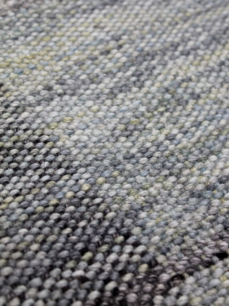 Trieste Teal rug with check design in shades of grey and blue/green, handwoven in 100% - close up texture detail image