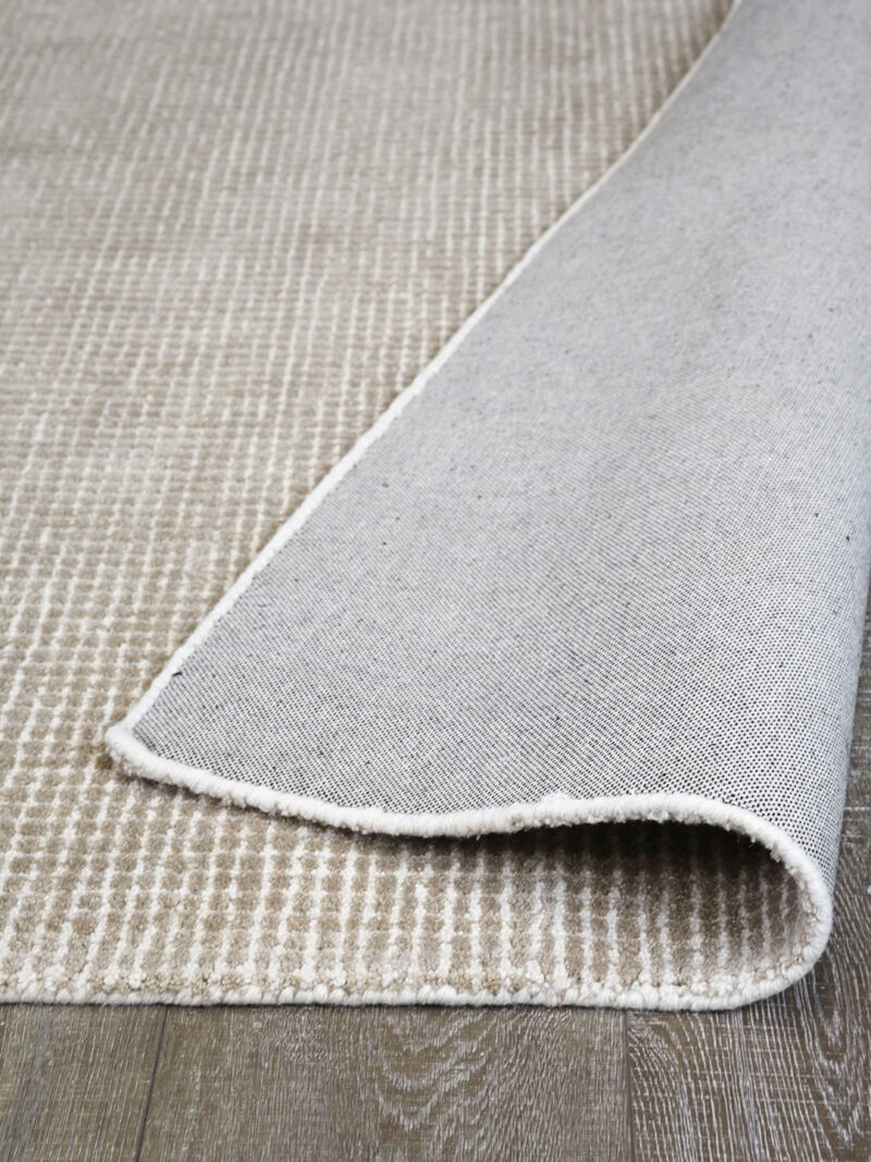 Capri Biscuit beige textured two-tone rug handmade from durable wool and nylon fibers - backing image