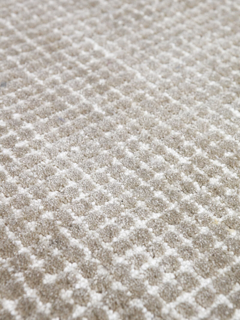 Capri Biscuit beige textured two-tone rug handmade from durable wool and nylon fibers - close up detail image