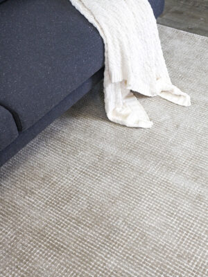 Capri Biscuit beige textured two-tone rug handmade from durable wool and nylon fibers - lifestyle image